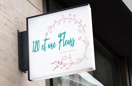 Création du logo de fleuristerie une couronne de fleurs par Geneviève MERCIER